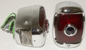 Tail Light Assembly With Script Glass Lens & Blue Dot, Left Side. Chrome Housing With License Light Photo Main