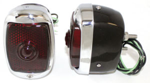 Tail Light Assembly With Script Glass Lens, Left Side. Black Housing With License Light Photo Main